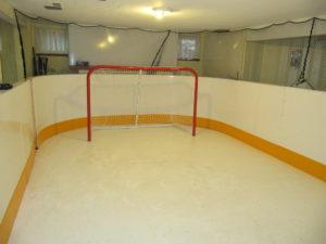 Basement synthetic ice rink