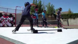 Kids playing on Hockeyshot synthetic ice tiles from the Revolution line