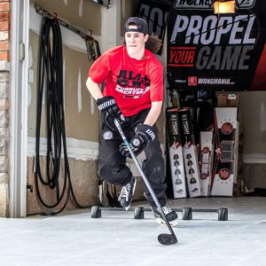 Hockey player training on Hockeyshot synthetic ice tiles