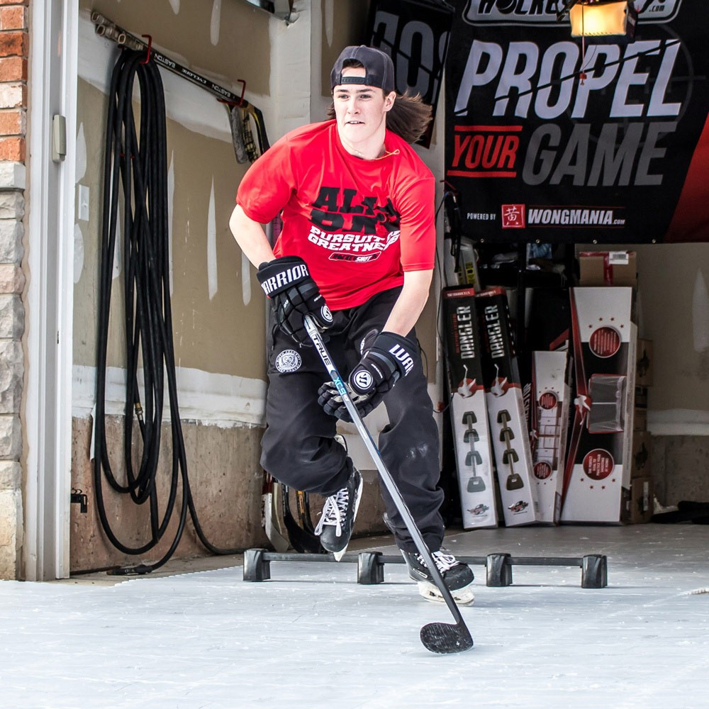 Hockey player training on Hockeyshot synthetic ice tiles