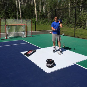 A player uses Hockeyshot synthetic ice tiles for shooting practice